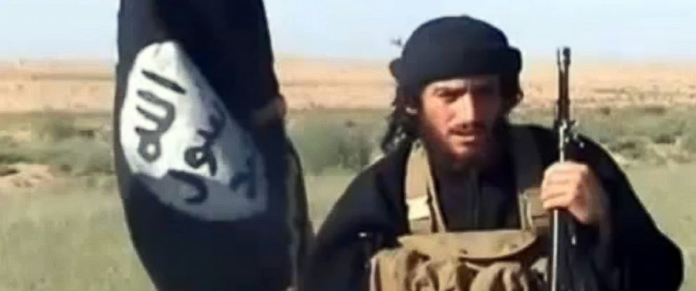 PHOTO: A grab taken on Oct. 2, 2013 from a video uploaded on YouTube on July 8, 2012, shows the spokesman for the Islamic State of Iraq and the Levant (ISIS), Abu Mohammad al-Adnani al-Shami, speaking next to an Islamist flag at an undisclosed location.