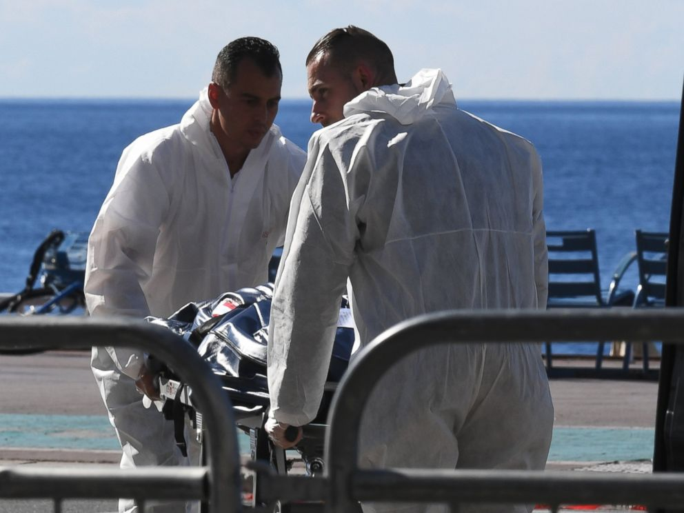 PHOTO: Forensics experts evacuate a dead body on the Promenade des Anglais seafront in the French Riviera town of Nice on July 15, 2016, after a gunman smashed a truck into a crowd of revelers celebrating Bastille Day.