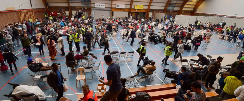 PHOTO: Travelers who were evacuated from Brussels airport take shelter at a sports complex in Zaventem, March 22, 2016.