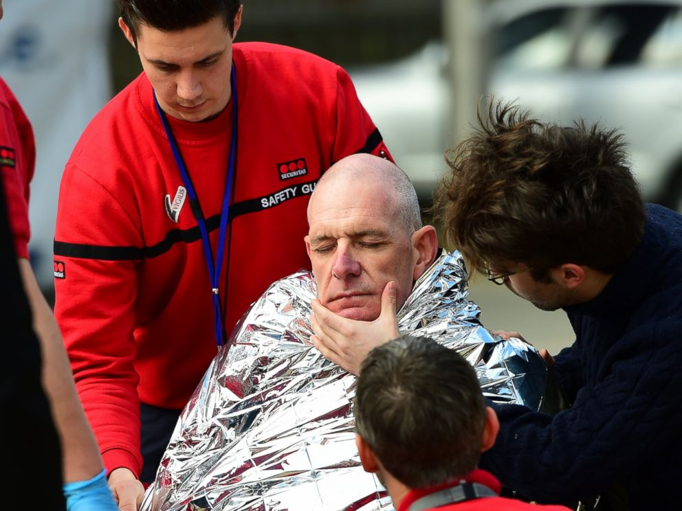 PHOTO: A victim receives first aid by rescuers, March 22, 2016 near Maalbeek metro station in Brussels, after a blast at this station near the EU institutions caused deaths and injuries.