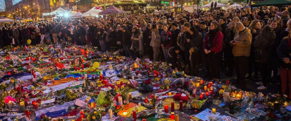 PHOTO: A picture taken on March 25, 2016 shows people gathering at a makeshift memorial in tribute to the victims of the Brussels terror attacks, on Place de la Bourse square in Brussels.
