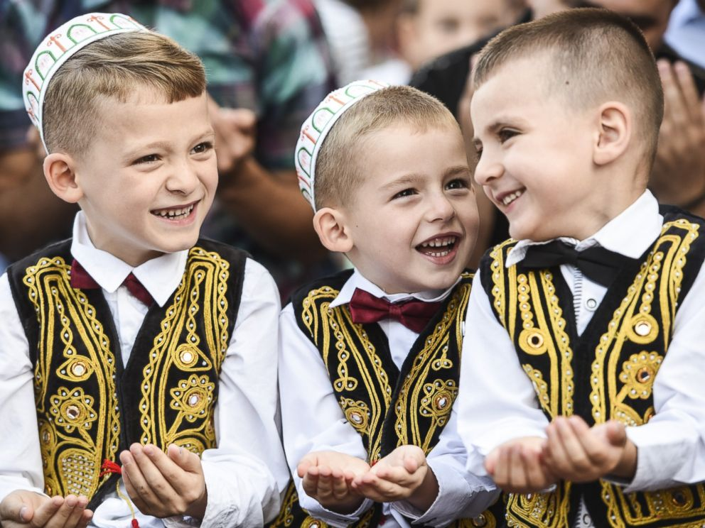 PHOTO: Young Kosovo muslims take part in a prayer during a celebration of Eid al-Fitr marking the end of the fasting month of Ramadan at the Sulltan Mehmet Fatih mosque in Pristina on July 17, 2015.