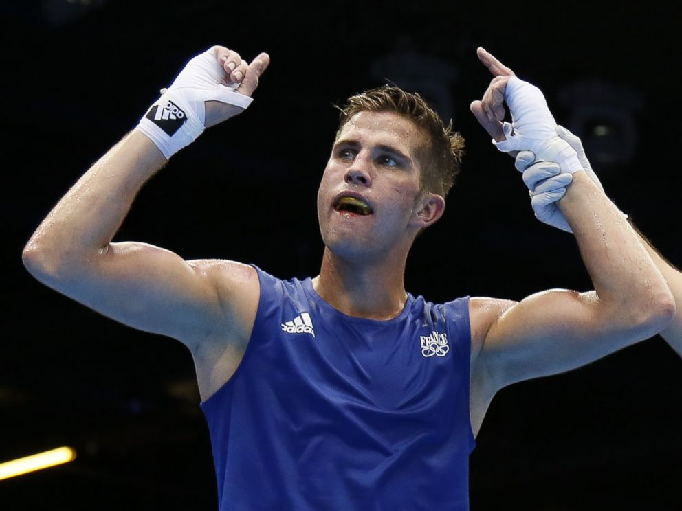 PHOTO: Alexis Vastine of France is declared winner over Tuvshinbat Byamba of Mongolia in their round of 16 Welterwight match of the London 2012 Olympic Games at the ExCel Arena on August 3, 2012 in London.