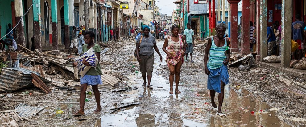 PHOTO: Picture taken by the U.N. Mission in Haiti (MINUSTAH) in the town of Jeremie, Haiti, on Oct. 6, 2016, showing people walking down a flooded street.