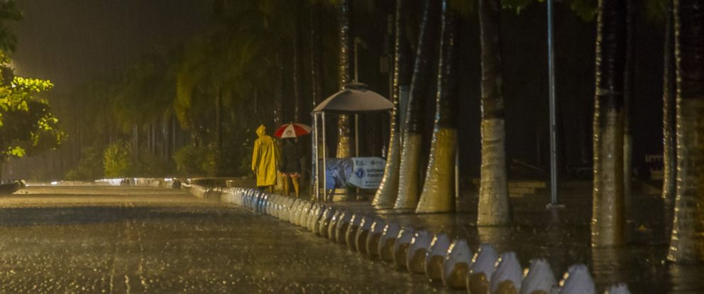 PHOTO: People walk under the rain during the arrival of hurricane Patricia in Puerto Vallarta, Mexico on October 23 ,2015.