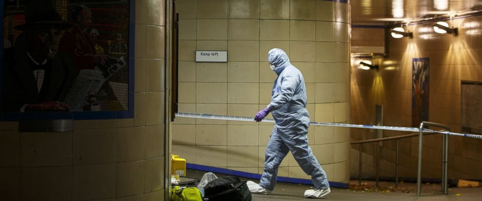 PHOTO: LONDON, UNITED KINGDOM - DECEMBER 05: Police officers and crime scene investigators investigate a crime scene at Leytonstone tube station in east London, England, on December 05, 2015.