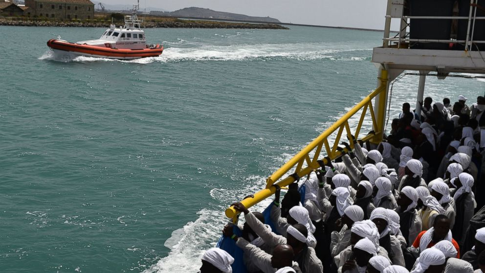 "Migrants arrive in the port of Cagliari, Sardinia, aboard rescue ship ""Aquarius"", on May 26, 2016, two days after being rescued near the Libyan coasts."