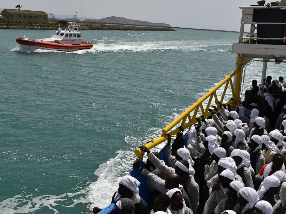 PHOTO: Migrants arrive in the port of Cagliari, Sardinia, aboard rescue ship Aquarius, on May 26, 2016, two days after being rescued near the Libyan coasts.