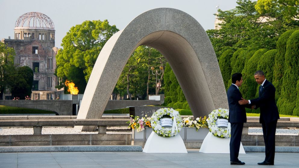 President Barack Obama and Japanese Prime Minister Shinzo Abe shake hands after laying wreaths at the Hiroshima Peace Memorial Park in Hiroshima on May 27, 2016.Obama on May 27 paid moving tribute to victims of the world's first nuclear attack.  / AFP / JIM WATSON        (Photo credit should read JIM WATSON/AFP/Getty Images)