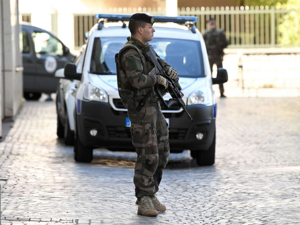 PHOTO: An armed French soldier stands near the site where a car slammed into soldiers on patrol in Levallois-Perret, outside Paris, on August 9, 2017.