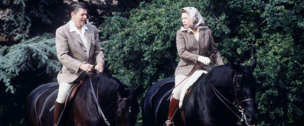 PHOTO: The queen rides with President Ronald Reagan on the grounds of Windsor Castle during his state visit on June 8, 1982.