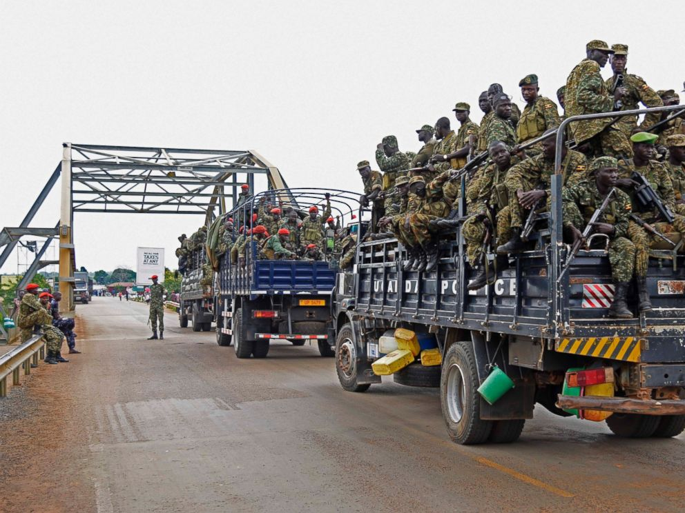 PHOTO: Uganda military personnel are seen atop military and police trucks as they drive towards Juba in South Sudan at Nimule border point, on July 14, 2016.