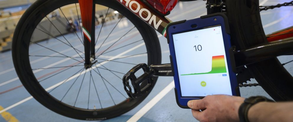 PHOTO: A staff member of the International Cycling Union (UCI) holds a tablet to scan a bicycle during a demonstration on testing for technological fraud and detecting the presence of a motor inside the frame, May 3, 2016.