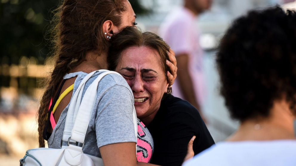A mother of victims reacts outside a forensic medicine building close to Istanbul's airport, June 29, 2016.