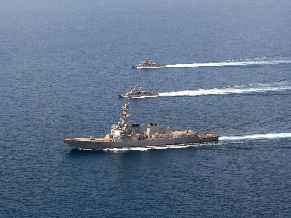 PHOTO: A file image released by the US Navy shows a guided-missile destroyer USS Mason (DDG 87) conducting formation exercises with the Cyclone-class patrol crafts USS Tempest (PC 2) and USS Squall (PC 7), on Sept. 10, 2016.