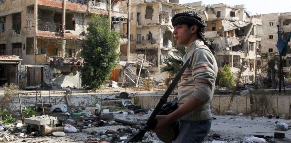 PHOTO: Syrian youth opposition fighter Faris, 16-years old, patrols with his weapon in the Salah al-Din neighborhood of the northern Syrian city of Aleppo, Nov. 17, 2013.