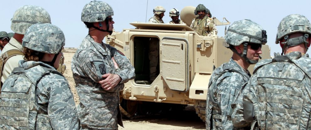 PHOTO: US military observers look on as Iraqi soldiers attend training at the Besmaya military base