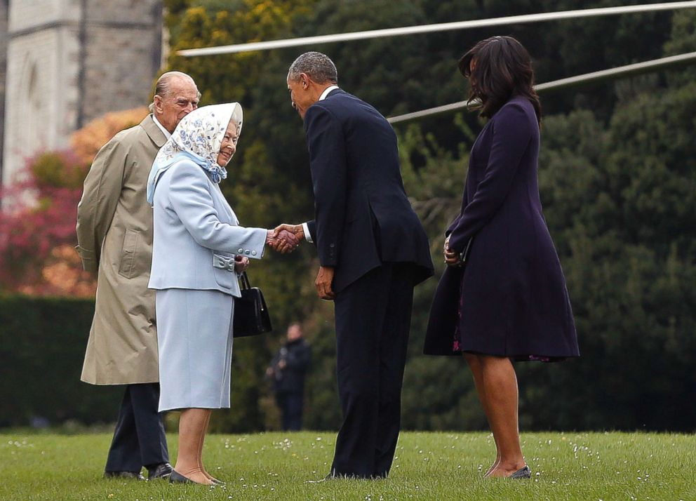 PHOTO: Former President Barack Obama and his wife former first lady Michelle Obama are greeted by Queen Elizabeth II and Prince Phillip, Duke of Edinburgh after landing by helicopter at Windsor Castle for a private lunch on April 22, 2016.