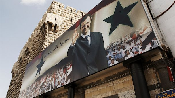 PHOTO: A wall poster features the portrait of Bashar el-Assad, May 2008.