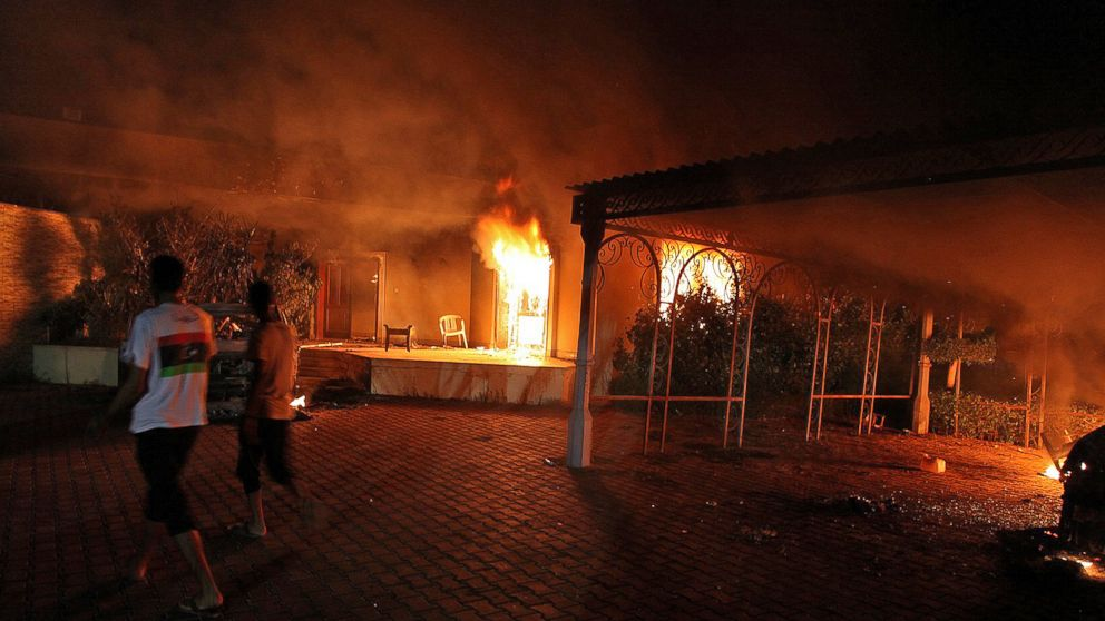 A vehicle and the surrounding buildings burn after they were set on fire inside the US consulate compound in Benghazi, Libya, Sept. 11, 2012.