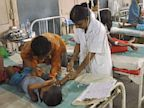 PHOTO: Indian schoolchildren recovering from food poisoning receive medical treatment at the Patna Medical College and Hospital in Patna,  July 20, 2013.