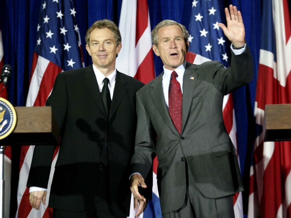 PHOTO: George W. Bush, right, and Tony Blair wave after their joint press conference at Crawford High School 06, April 2002, in Crawford, Texas. The Blairs joined the Bushs at their 1,600 acre Prairie Chapel Ranch for the weekend.