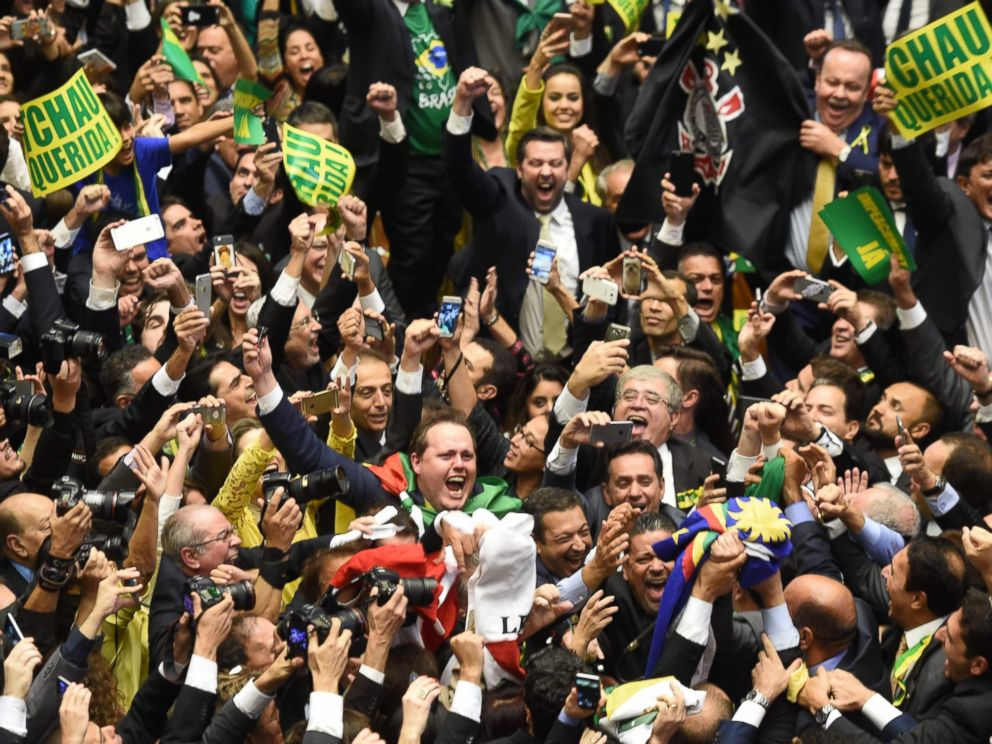PHOTO: Brazils lawmakers celebrate after they reached the votes needed to authorize President Dilma Rousseffs impeachment to go ahead, at the Congress in Brasilia, April 17, 2016.