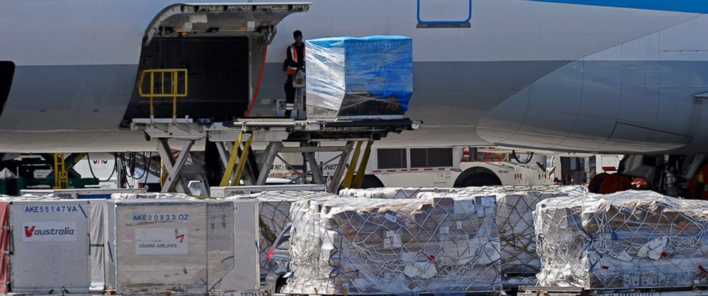 PHOTO: Airline workers load cargo at Los Angeles International Airport, Oct.30, 2010, one day after a plot was exposed to take down cargo planes over the United States using bombs disguised as ink cartridges.