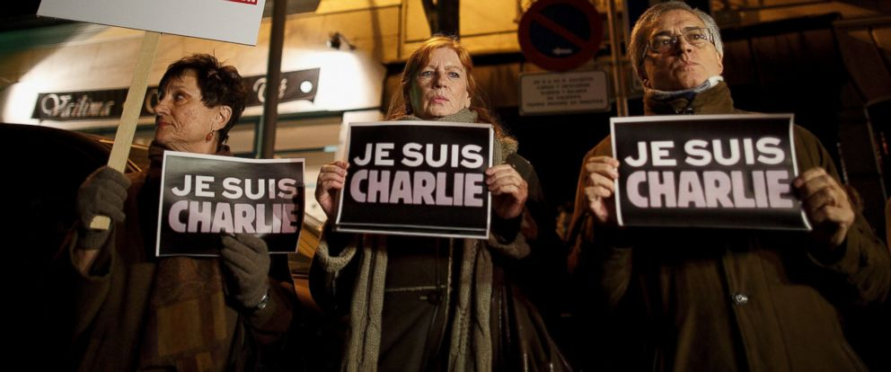 """PHOTO: People hold signs reading """"Je Suis Charlie"""" in front of the Embassy of France on Jan. 7, 2015 in Madrid, Spain."""