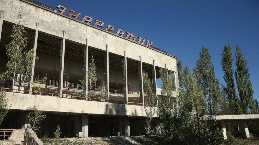 "The abandoned ""Energetik"" cultural center, that once housed a library, lecture halls and sports facilities, stands on the former main square overgrown with trees, Sept. 30, 2015 in Pripyat, Ukraine."
