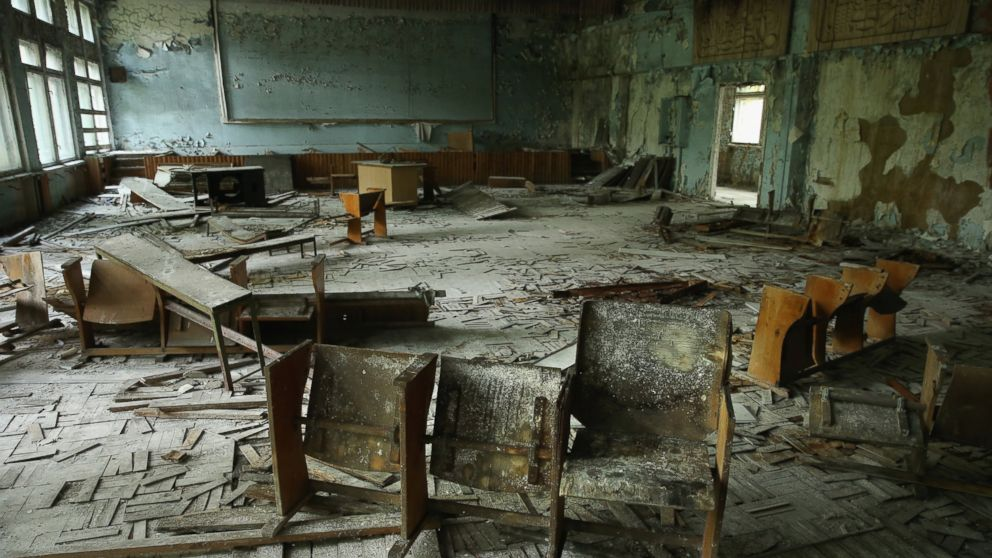 Chairs stand on rotting floorboards in an auditorium of abandoned School Number 3, Sept. 30, 2015, in Pripyat, Ukraine.