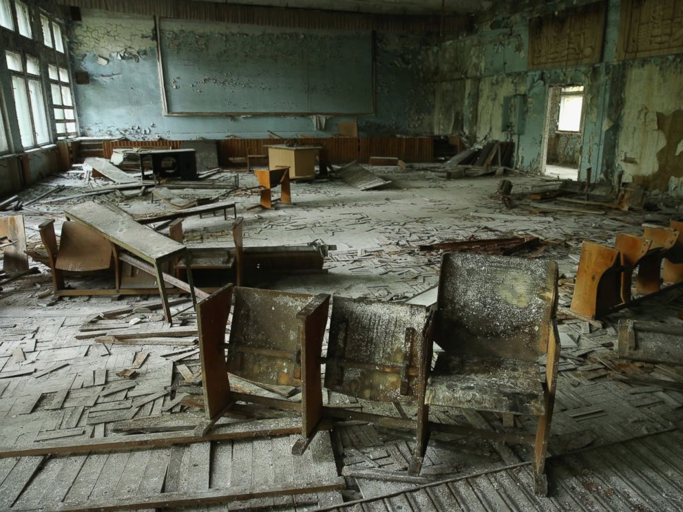 PHOTO: Chairs stand on rotting floorboards in an auditorium of abandoned School Number 3, Sept. 30, 2015, in Pripyat, Ukraine.