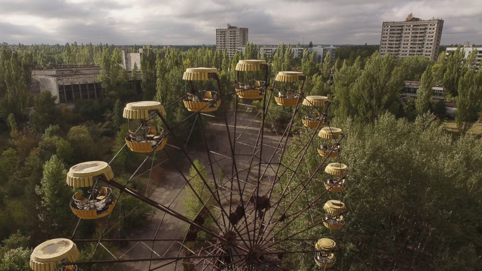 In this aerial view, an abandoned ferris wheel stands on a public space overgrown with trees in the former city center, Sept, 30, 2015 in Pripyat, Ukraine.