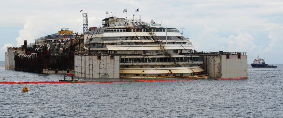 PHOTO: The wrecked ship Costa Concordia is seen after the successfully refloating operations on July 14, 2014 in Isola del Giglio, Italy.