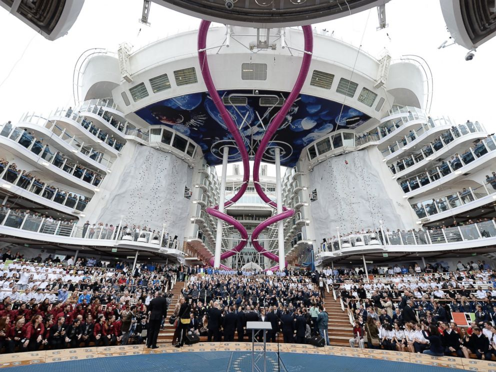 PHOTO: Crew members of the Harmony of the Seas cruise ship are pictured at the STX shipyard of Saint-Nazaire, western France on May 12, 2016 as they attend the delivery ceremony of the boat.