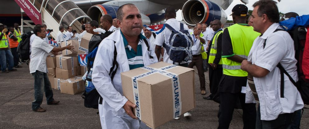 PHOTO: The first members of a team of 165 Cuban doctors and health workers unload boxes of medicine and medical materials from a plane in Sierra Leone on Oct. 2, 2014.