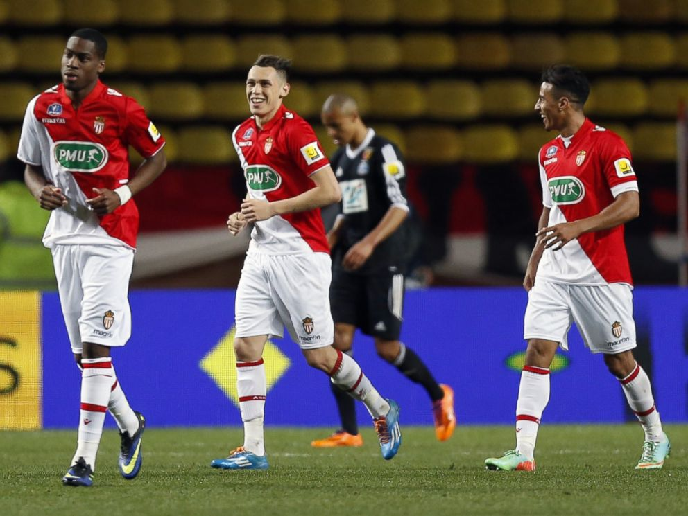 PHOTO: AS Monaco football team members celebrate after scoring during the French Cup football match between AS Monaco and RC Lens, March 26, 2014, at the Louis II stadium in Monaco.