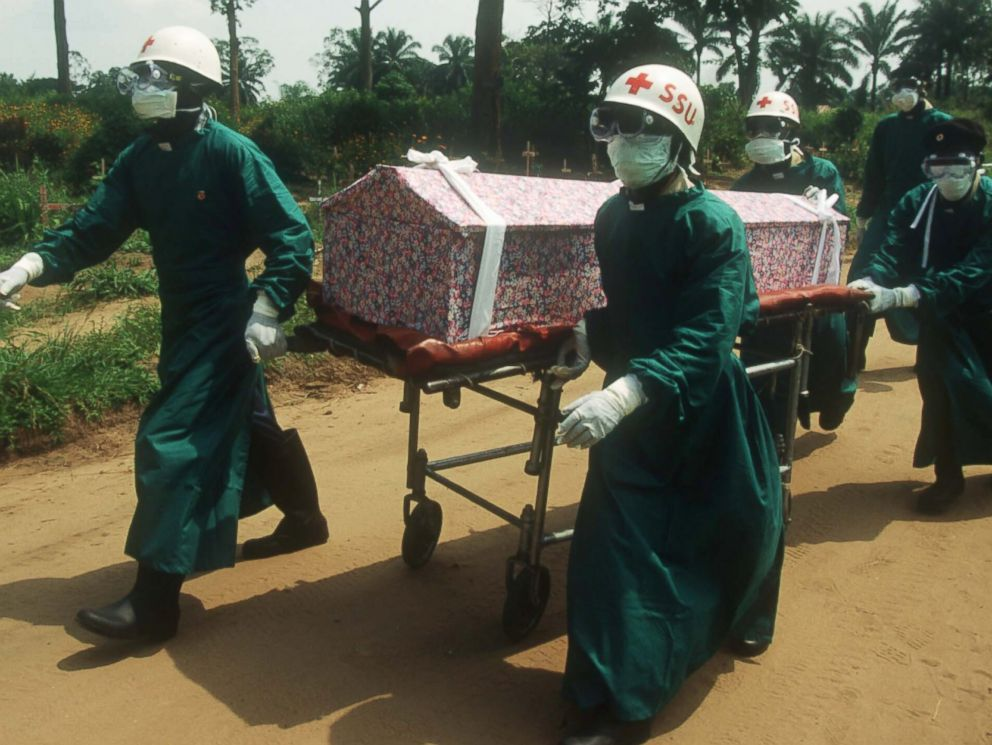 PHOTO: Health workers transport the casket of a nun whose death resulted from an Ebola infection on Jan. 1, 1995 in Kikwit, Zaire.