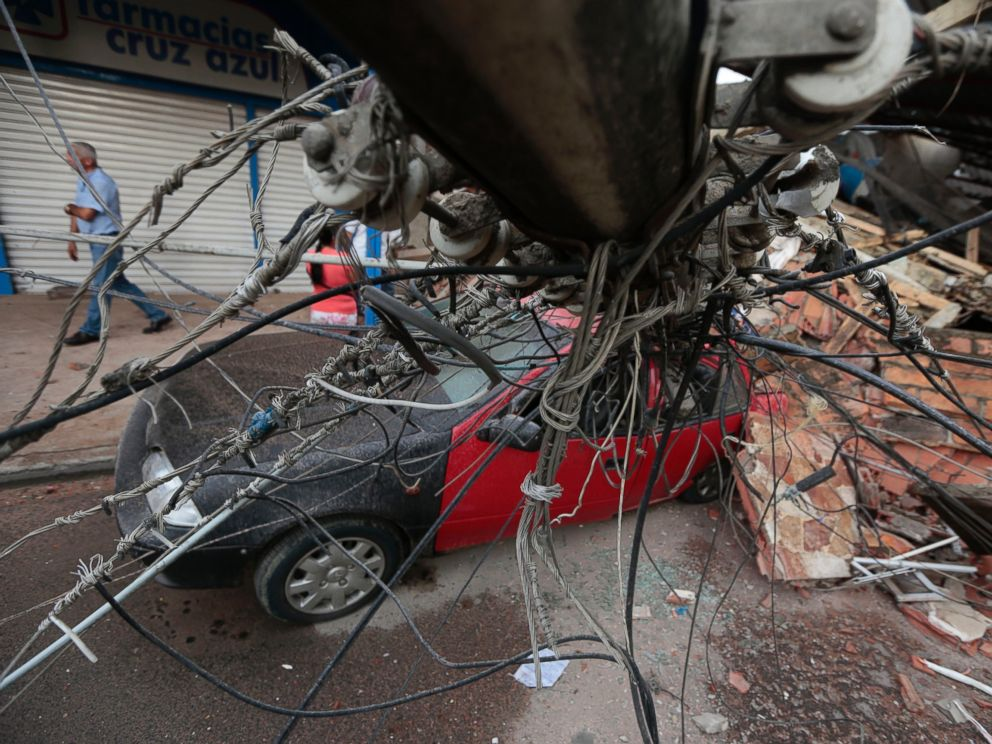 PHOTO: View of a car squashed by rubble after a 7.8-magnitude quake in Portoviejo, Ecuador on April 17, 2016.
