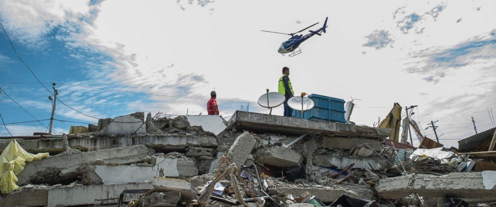 PHOTO: Search and rescue workers are seen on duty over the collapsed buildings in Pedernales, Manabi Province of Ecuador, April 17, 2016.