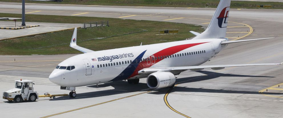 PHOTO: An aircraft operated by Malaysian Airline System Bhd. (MAS) is towed on the tarmac at Kuala Lumpur International Airport (KLIA) in Sepang, Malaysia, on March 25, 2014.