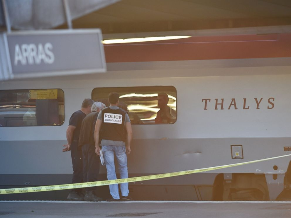 PHOTO: Crime investigators look into the window of a Thalys train of French national railway operator SNCF at the main train station in Arras, northern France, Aug. 21, 2015.