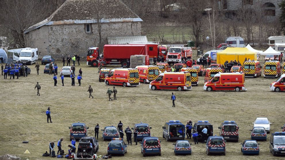 French emergency services workers and members of the French gendarmerie gather in Seyne, near the site where a Germanwings Airbus A320 crashed in the French Alps, March 24, 2015.