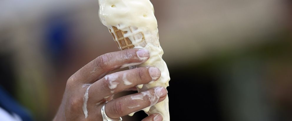 PHOTO: A woman eats melting ice cream on July 2, 2015 in Paris.
