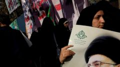 PHOTO: A Iranian protester holds a photo of supreme leader Ayatollah Ali Khamenei during a demonstration to mark the 34th anniversary of the 1979 U.S. embassy takeover Nov. 4, 2013, in Tehran, Iran.