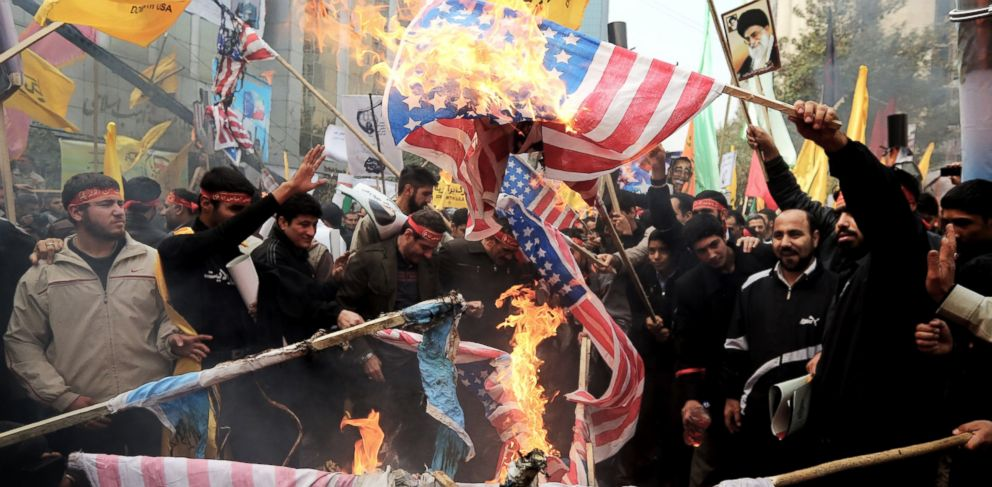 PHOTO: Iranians burn flags outside the former US embassy in Tehran, Nov. 4, 2013, during a demonstration to mark the 34th anniversary of the 1979 US embassy takeover.