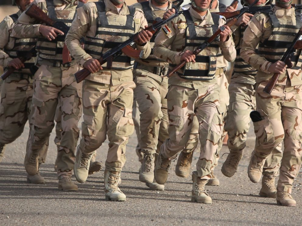 PHOTO: Iraqi soldiers take part in a training session, instructed by American and Iraqi military trainers, at the Taji base complex, located north of Baghdad on Jan. 7, 2015.