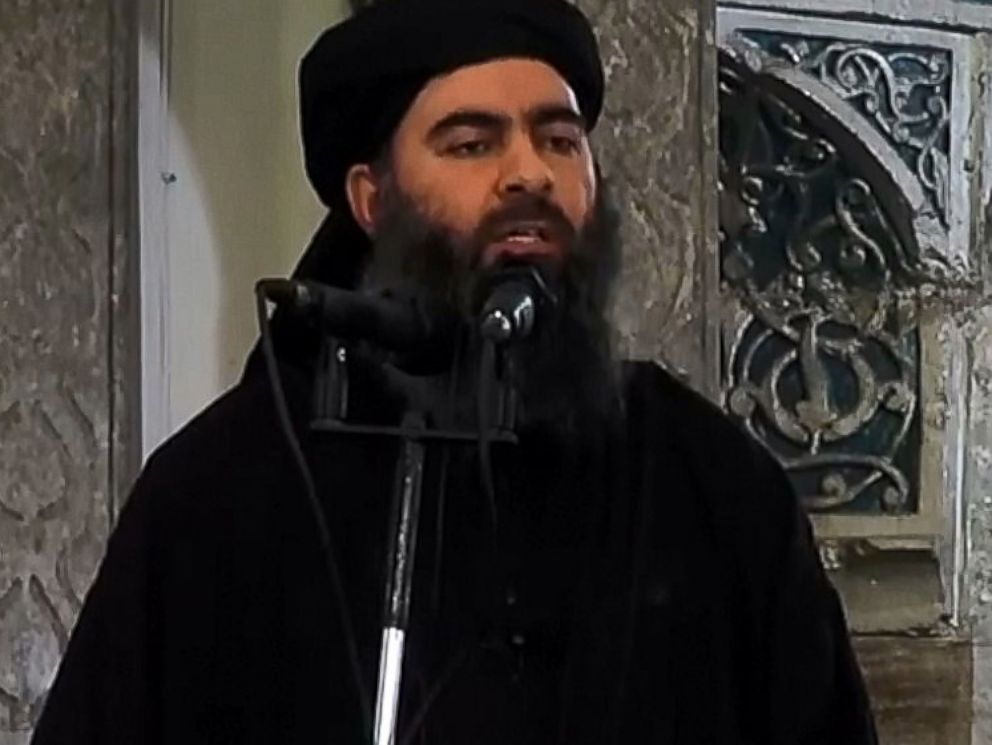 PHOTO: An image grab taken from a video released on July 5, 2014 by Al-Furqan Media shows alleged Islamic State of Iraq and the Levant leader Abu Bakr al-Baghdadi preaching during Friday prayer at a mosque in Mosul.
