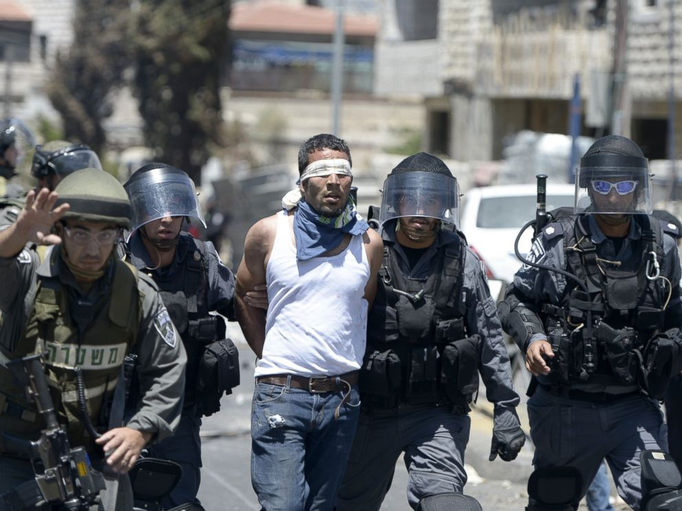 PHOTO: Israeli security forces detain a Palestinian man during a demonstration after Friday prayers