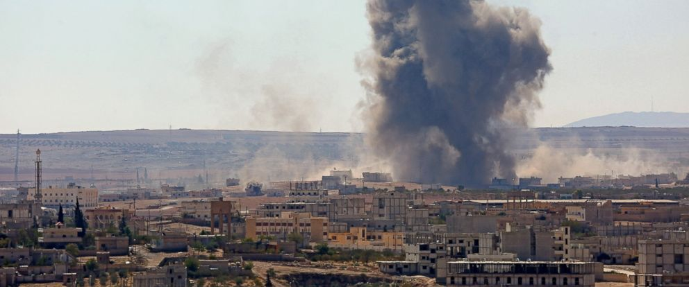 PHOTO: Smoke rises from Ayn al-Arab city (Kobani) of Syria after the US-led coalition bombed the targets of the Islamic State of Iraq and the Levant (ISIL) in Ayn al-Arab, Oct. 7, 2014.